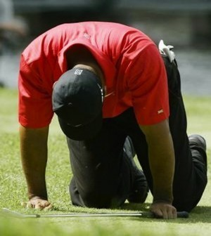 -c- AP Tiger Woods back injury