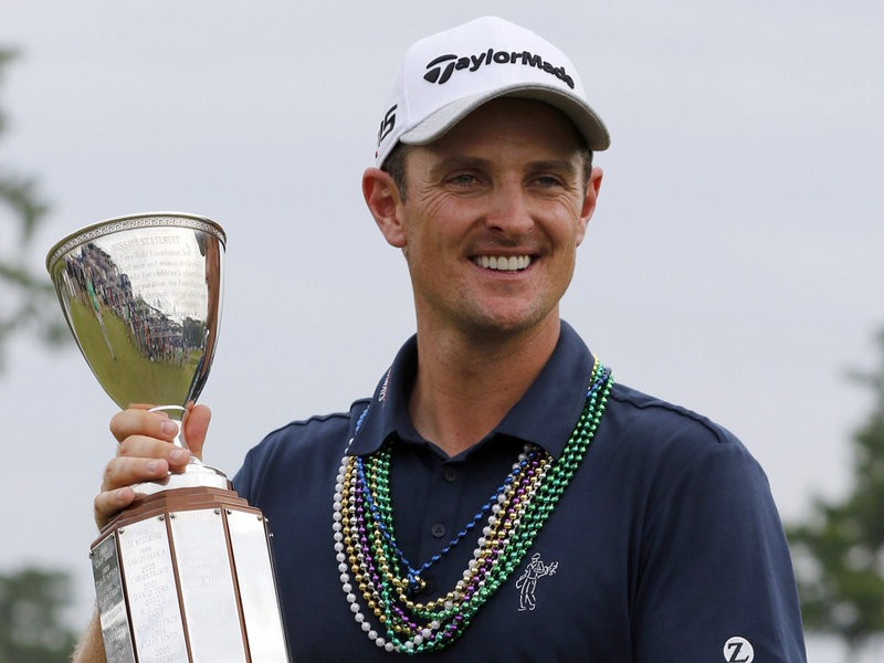 -c- getty Justin Rose trophy Zurich Classic